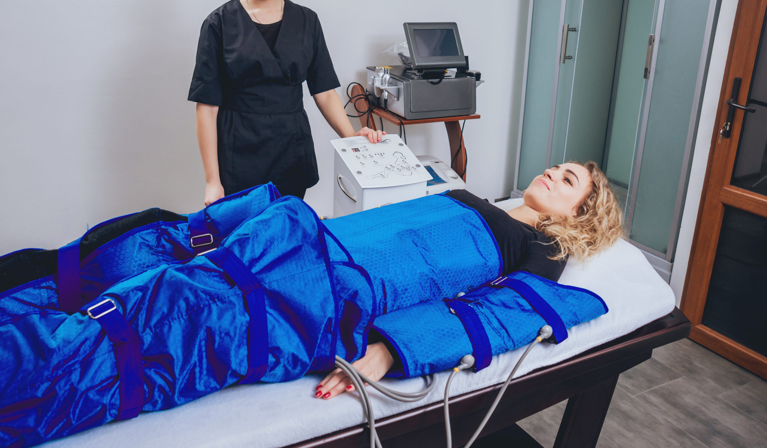 Pressotherapy machine on woman in beauty center. Cosmetic medicine devices